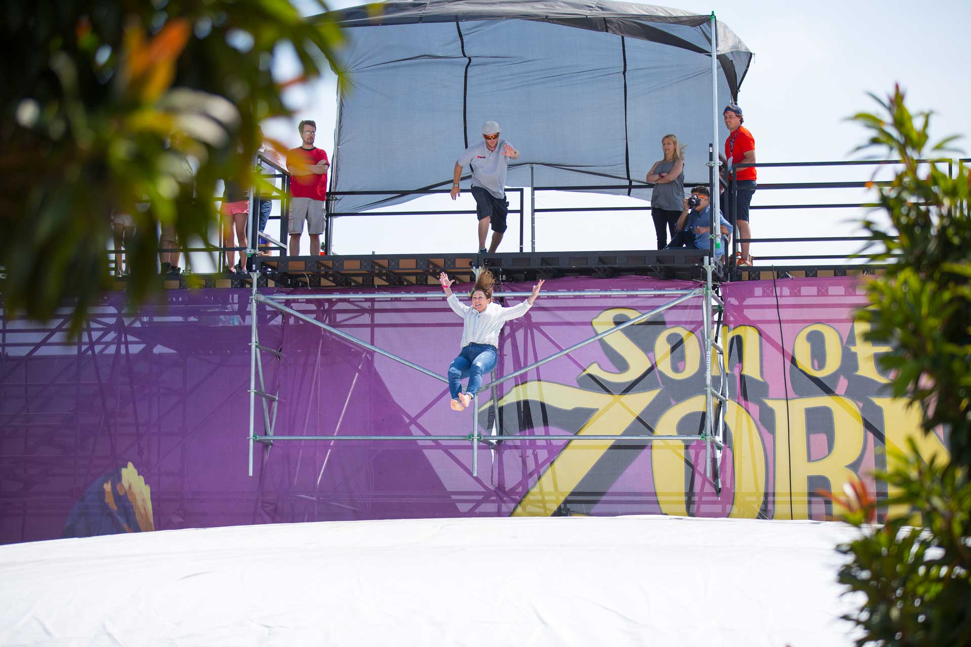 Woman jumping from platform at Son of Zorn